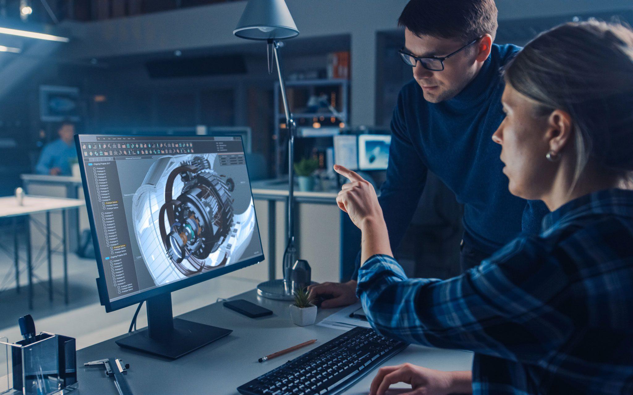 Ingenieur-Büro Mitarbeiter im Projektgespräch am CAD Arbeitsplatz